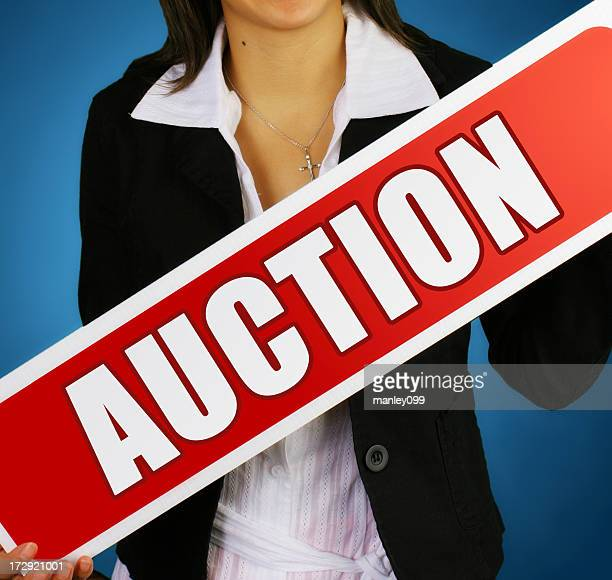 AUCTION real estate sign