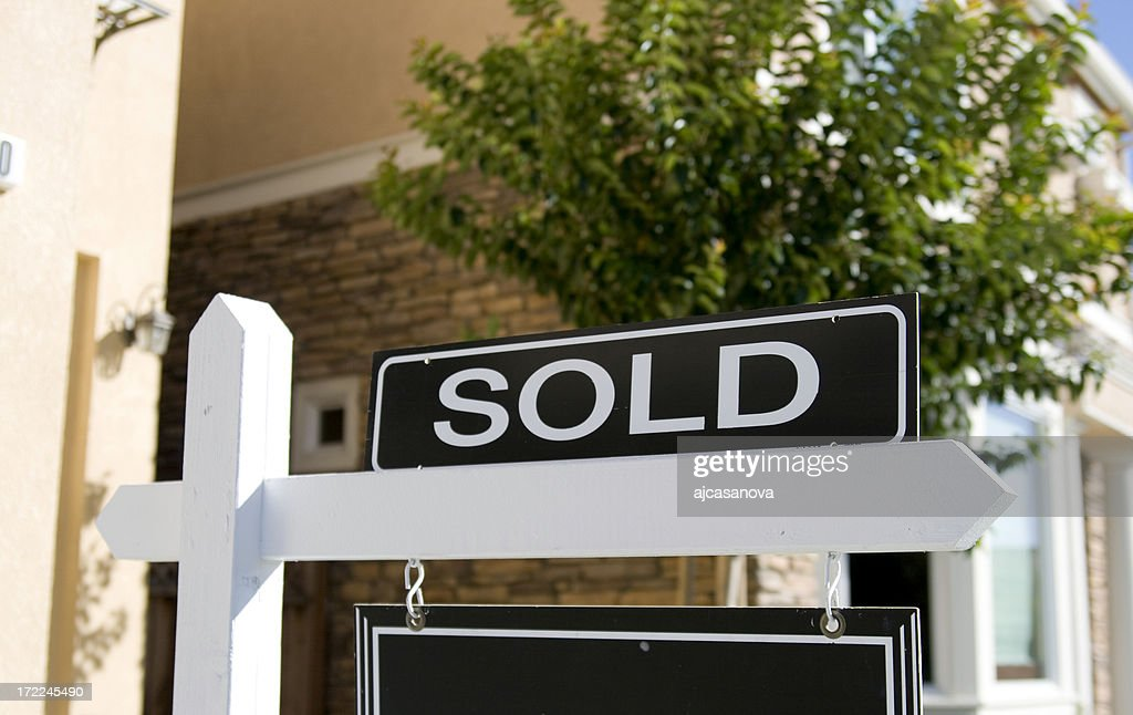 A real estate sign saying sold : Stock Photo