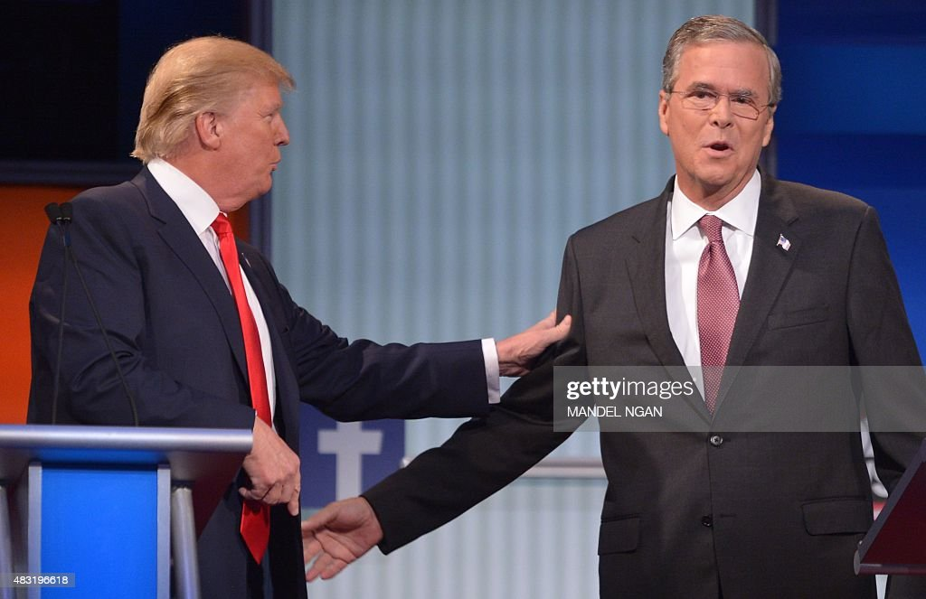 Real estate tycoon Donald Trump (L) and former Florida governor Jeb Bush (R) arrive on stage for the Republican presidential primary debate on August 6, 2015 at the Quicken Loans Arena in Cleveland, Ohio.