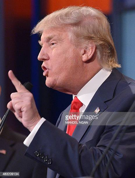 Real estate tycoon Donald Trump speaks during the prime time Republican presidential debate on August 6 2015 at the Quicken Loans Arena in Cleveland...