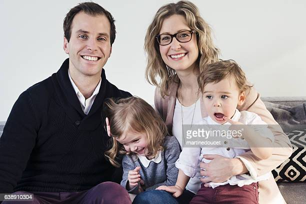 "real family portrait of young couple with two small children. - ""martine doucet"" or martinedoucet stock pictures, royalty-free photos & images"