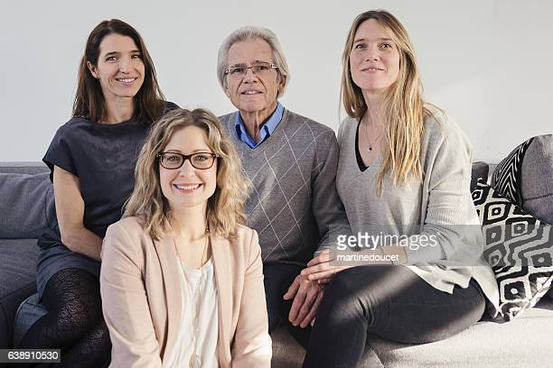 """real family portrait senior father with daughters and step-daughter. - """"martine doucet"""" or martinedoucet stock pictures, royalty-free photos & images"""