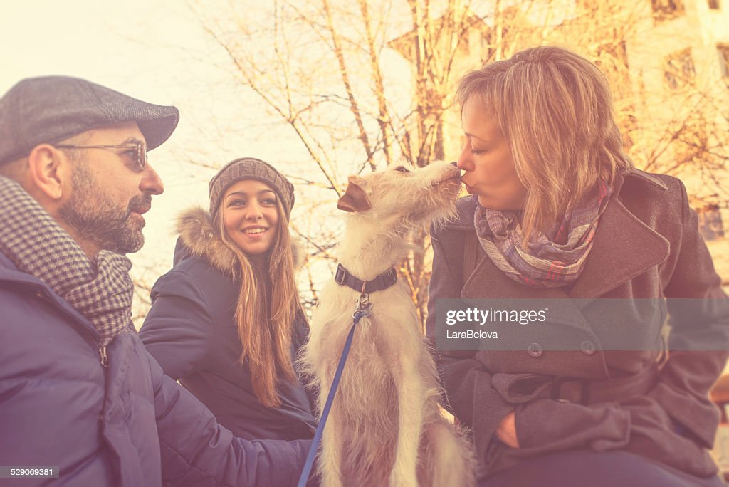 Real family with adopted by them dog : Stock Photo