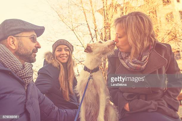 Real family with adopted by them dog