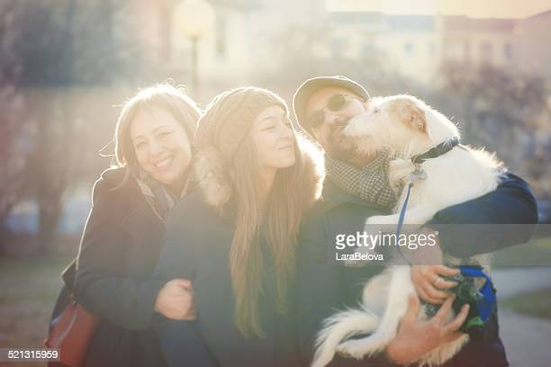 real family with dog in the park - one animal stock photos and pictures