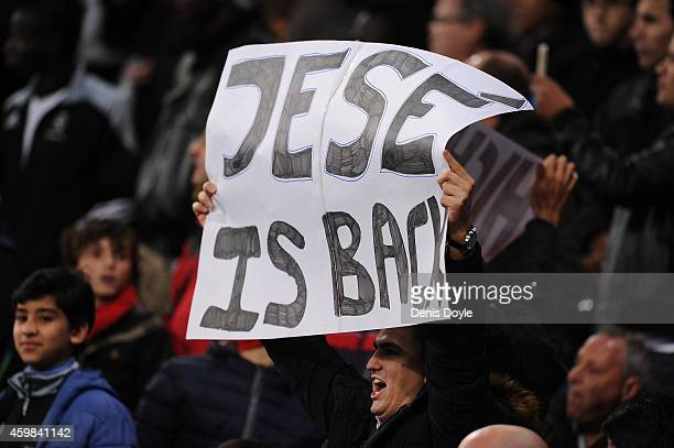 Real fan hold up a sign while Jese Rodriguez of Real Madrid comes on as a substitute after a long injury during the Copa Del Rey Round of 32 Second...