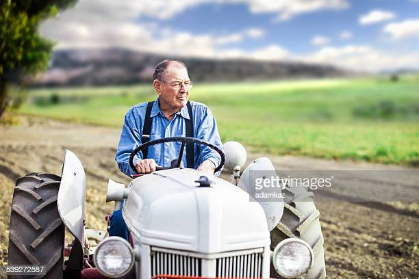 real farmer on tractor - tractor stock pictures, royalty-free photos & images
