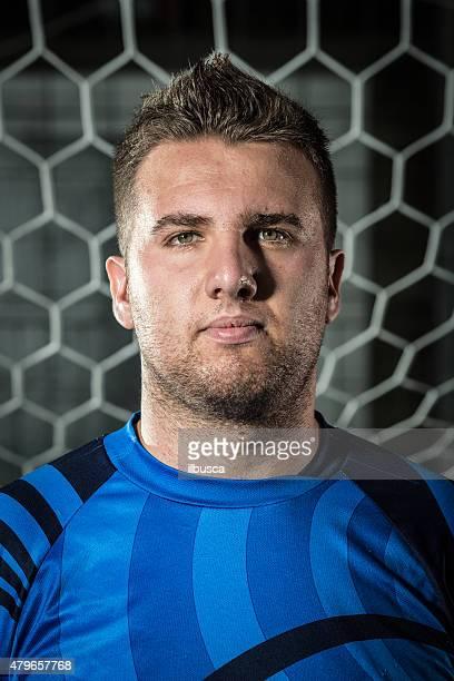 Real footballer portrait in front of goal: goalkeeper