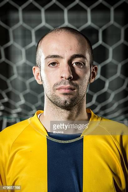 Real footballer portrait in front of goal