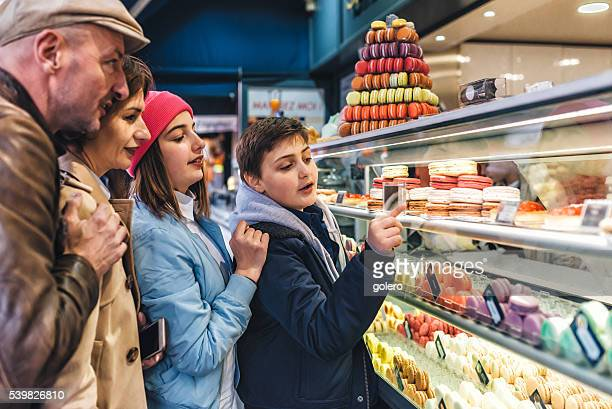 real french family at paris macarons stall