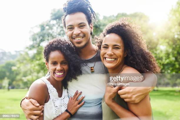 real friends treat you like family - polyamory stock photos and pictures
