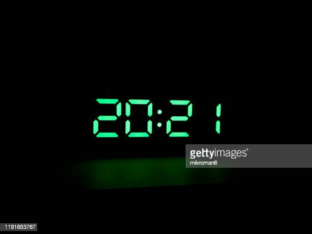 real green led digital clock showing time 20:21 - number stock pictures, royalty-free photos & images