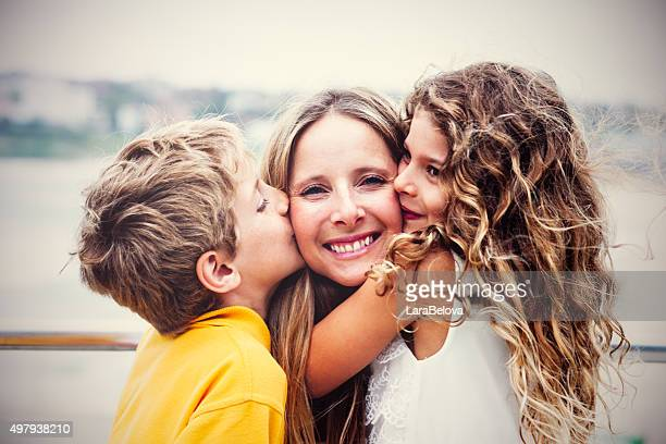 real happy mother with her kids - family with two children stock photos and pictures