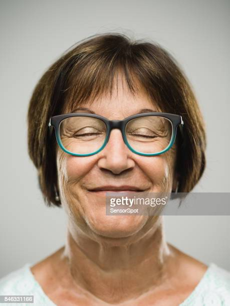 Real happy senior woman portrait with eyes closed