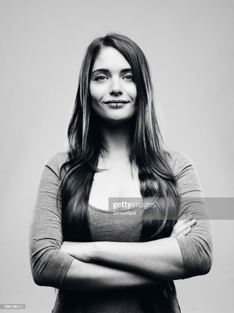 Real happy young woman studio portrait : Stock Photo