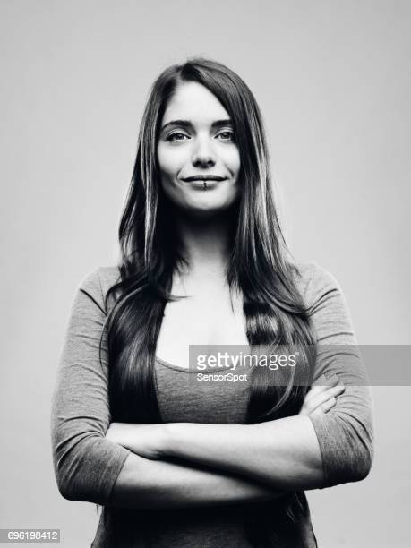 Real happy young woman studio portrait