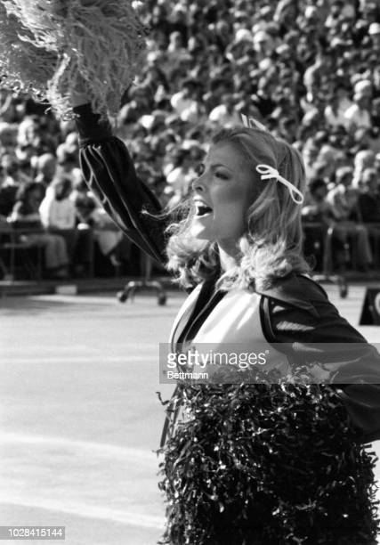 Real honey from any viewpoint is Honey Bear Patty Loisi going through her routine at the Chicago Bear-Oakland Raider game in Soldier Field. Chicago's...
