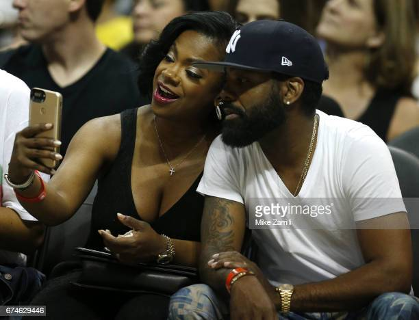 'Real Housewives of Atlanta' cast member Kandi Burress takes a selfie with her husband Todd Tucker during Game Six of the Eastern Conference...
