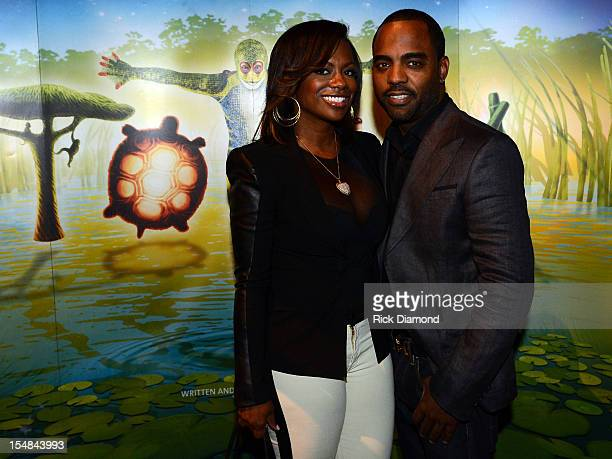 """Real Housewives of Atlanta"""" cast member Kandi Burruss and Todd Tucker attend Cirque du Soleil TOTEM Premiere at Atlantic Station on October 26, 2012..."""