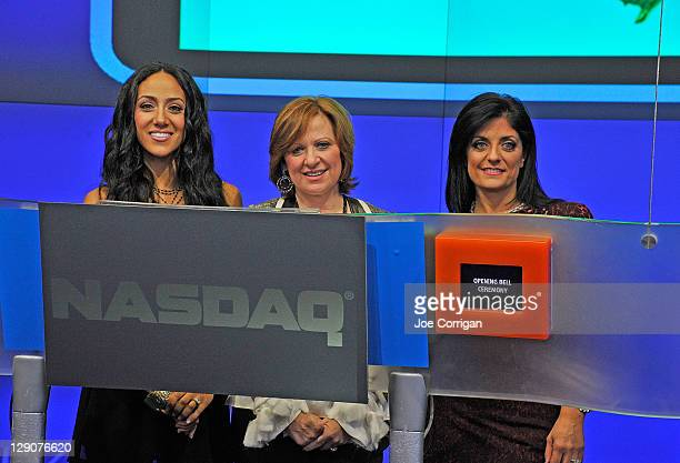 Real Housewives of New Jersey cast member's Melissa Gorga Caroline Manzo and Kathy Wakile ring the opening bell at NASDAQ on October 12 2011 in New...