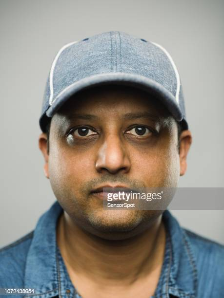 real indian man with blank expression - baseball cap stock pictures, royalty-free photos & images