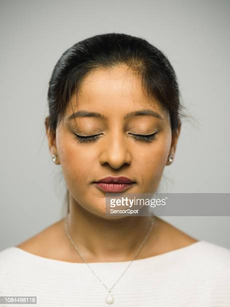 real indian young woman with blank expression and closed eyes - eyes closed stock pictures, royalty-free photos & images