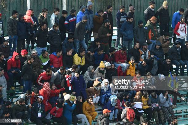 Real Kashmir fans watch the I-League football match between Real Kashmir and Chennai City at the TRC Turf Ground in Srinagar on December 26, 2019.