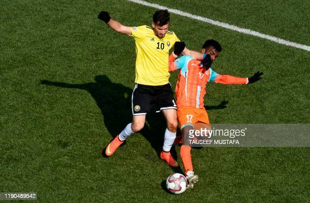 Real Kashmir player Danish Farooq fight for the ball with Chennai City's Charles Anandraj Lourdusamy during their I-League football match at the TRC...