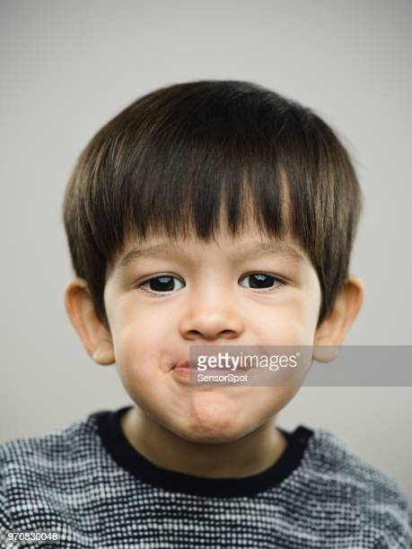 real kid making a face - kid middle finger stock pictures, royalty-free photos & images