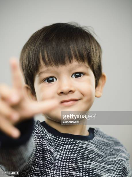 Real kid pointing with sweet smile
