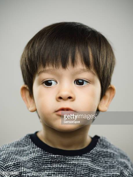 Real kid with distracted expression