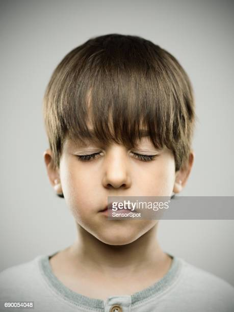 Real kid with eyes closed
