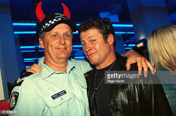 APRIL 2002 Real life policeman senior constable Simon Gallant and Peter Phelps From the TV show Stingers The party for the launch of the new Virgin...