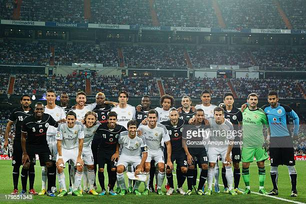 Real Madrid and Al Sadd pose together prior to start the Santiago Bernabeu Trophy match between Real Madrid CF and Al-Sadd at Estadio Santiago...