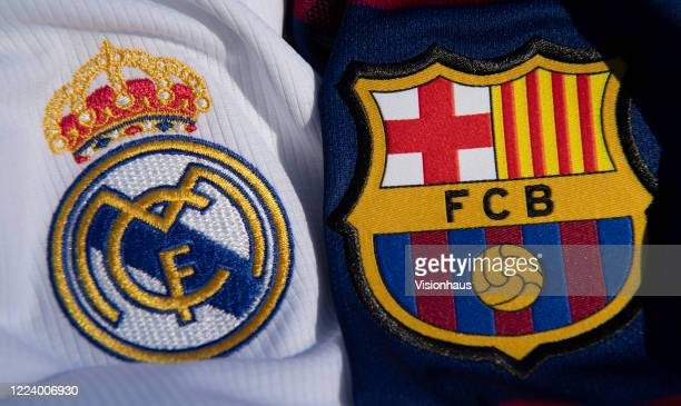 Real Madrid and Barcelona club crests on their respective home shirts for the 2019-20 season on May 6, 2020 in Warwickshire, UK.