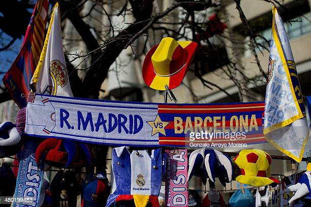 Real Madrid and Barcelona scarves are displayed outside the ground prior to the La Liga match between Real Madrid CF and FC Barcelona at the Bernabeu...