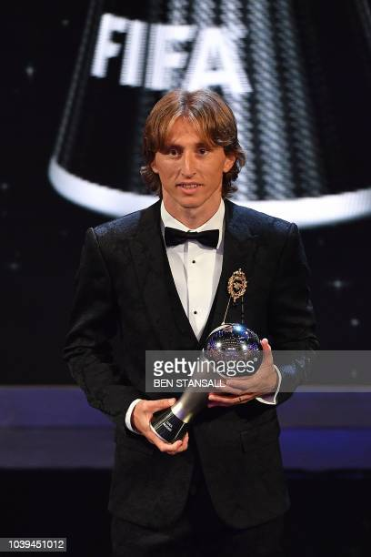 Real Madrid and Croatia midfielder Luka Modric poses for a photograph after winning the trophy for the Best FIFA Men's Player of 2018 Award during...