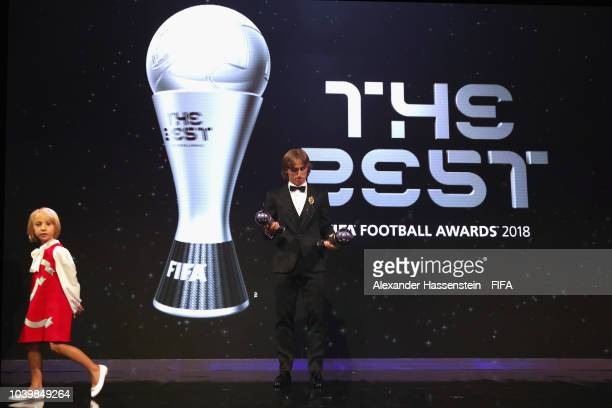 Real Madrid and Croatia midfielder Luka Modric poses with his awards next to his daughter Ema during The Best FIFA Football Awards at Royal Festival...