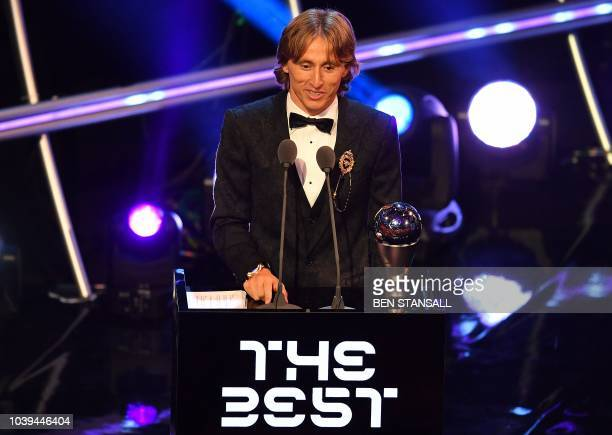 TOPSHOT Real Madrid and Croatia midfielder Luka Modric speaks after winning the trophy for the Best FIFA Men's Player of 2018 Award during The Best...