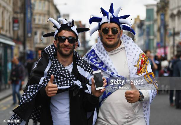 Real Madrid and Juventus fan enjoy the city centre atmosphere prior to the UEFA Champions League Final between Juventus and Real Madrid on June 3...