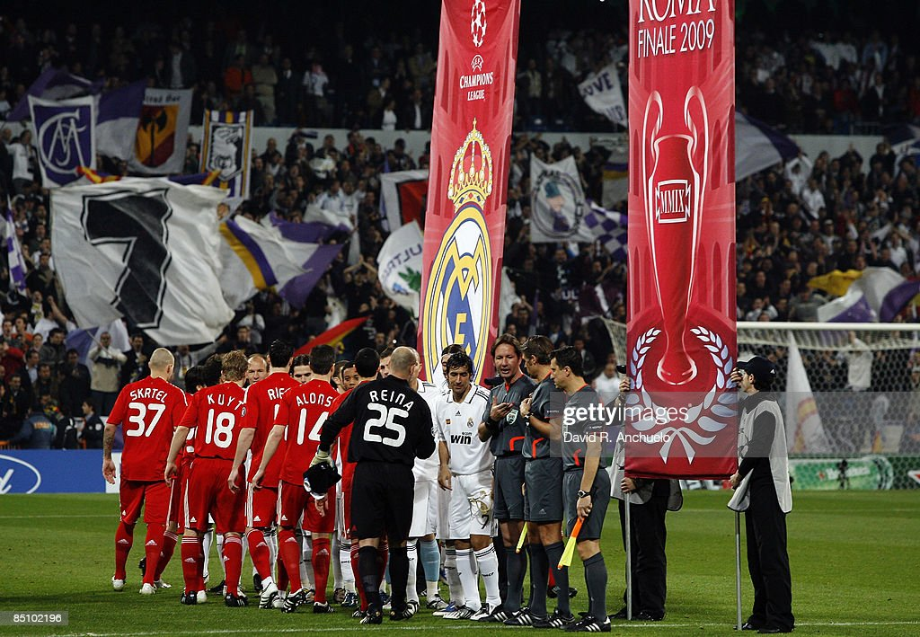 Real Madrid And Liverpool Players Line Up Before The Uefa