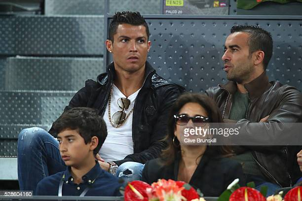 Real Madrid and Portugal footballer Cristiano Ronaldo watches Rafael Nadal of Spain in action against Joao Sousa of Portugal in their quarter final...