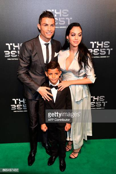 Real Madrid and Portugal forward Cristiano Ronaldo poses for a photograph with partner Georgina Rodriguez and his son Cristiano Ronaldo Jr as he...