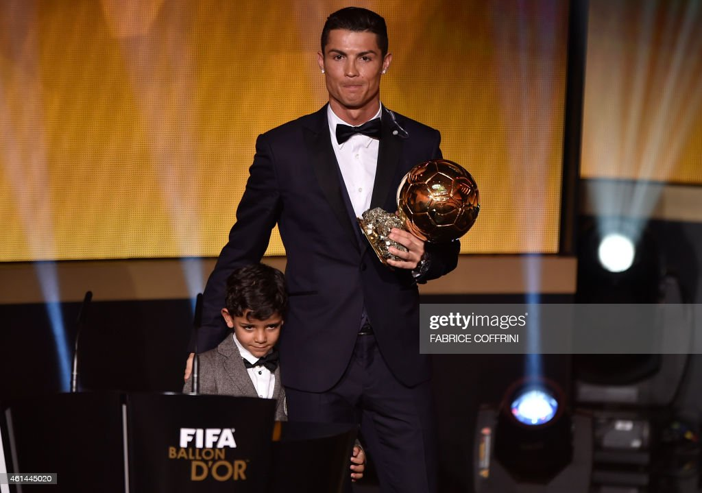 Real Madrid and Portugal forward Cristiano Ronaldo (R) poses with his son Cristiano Jr after receiving the 2014 FIFA Ballon d'Or award ceremony at the Kongresshaus in Zurich on January 12, 2015. AFP PHOTO / FABRICE COFFRINI / AFP PHOTO / Fabrice COFFRINI