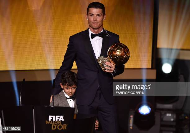 Real Madrid and Portugal forward Cristiano Ronaldo poses with his son Cristiano Jr after receiving the 2014 FIFA Ballon d'Or award ceremony at the...