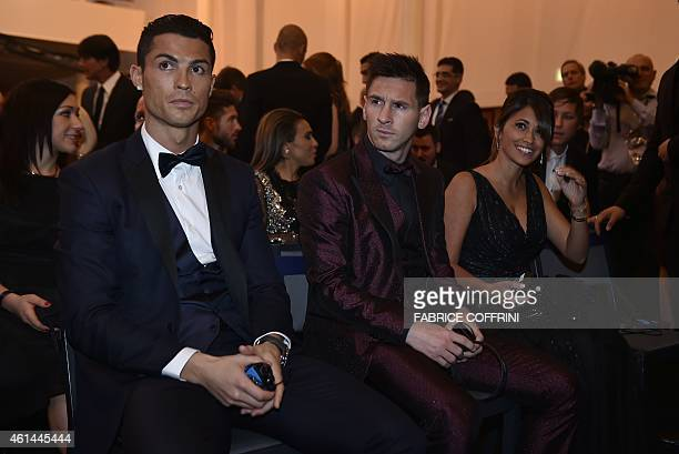 Real Madrid and Portugal forward Cristiano Ronaldo sits next to Barcelona and Argentina forward Lionel Messi and his wife Argentinian model Antonella...