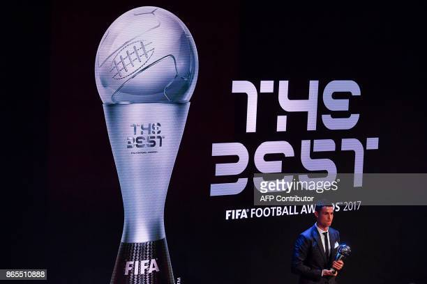 Real Madrid and Portugal forward Cristiano Ronaldo stands with the trophy after winning The Best FIFA Men's Player of 2017 Award during The Best FIFA...