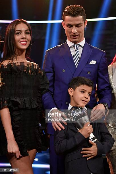 Real Madrid and Portugal's forward and winner of The Best FIFA Mens Player of 2016 Award Cristiano Ronaldo poses with partner Georgina Rodriguez and...