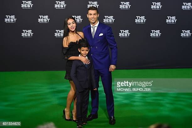TOPSHOT Real Madrid and Portugal's forward Cristiano Ronaldo poses with partner Georgina Rodriguez and his son Cristiano Ronaldo Jr as they arrive...