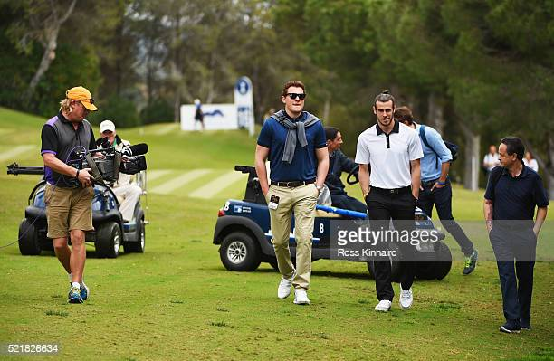 Real Madrid and Wales footballer Gareth Bale walks along the 16th fairway as he watches Sergio Garcia's group on the 16th hole during the final round...